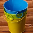 图库照片: Colour Tin Buckets