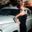 Beautiful sexy woman standing near old car in retro style — Stok fotoğraf #18631963