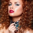 Sexy redhead young woman model with jewelery — Stock Photo