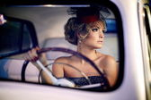 Beautiful sexy woman sitting in old car in retro style — Zdjęcie stockowe