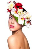Brunette woman with colorful flowers on head — Stock Photo