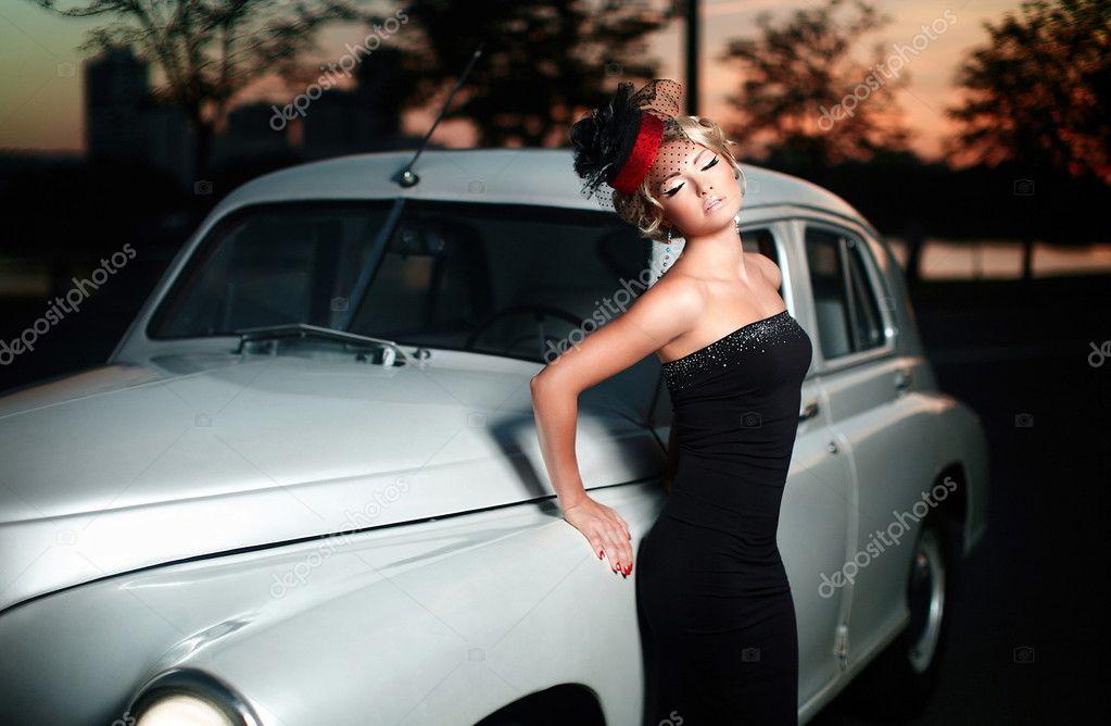 http://st.depositphotos.com/1273429/1863/i/950/depositphotos_18631963-Beautiful-sexy-woman-standing-near-old-car-in-retro-style.jpg