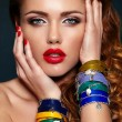High fashion look.glamor closeup portrait of beautiful sexy stylish blond Caucasian young woman model with bright makeup, with red lips, with perfect clean skin with colorful accessories — Stock Photo #23195668