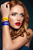 High fashion look.glamor closeup portrait of beautiful sexy stylish blond Caucasian young woman model with bright makeup, with red lips, with perfect clean skin with colorful accessories — Stock Photo