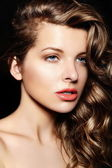 High fashion look.glamor closeup portrait of beautiful sexy stylish brunette Caucasian young woman model with bright makeup, with curly healty hair with blue eyes big lips in studio — Stock Photo