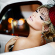 Portrait of beautiful sexy fashion stylish blond girl model with bright makeup in retro style sitting in old car — Stock Photo #43148641