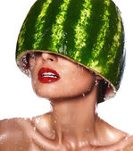 High fashion look.glamor closeup portrait of beautiful sexy young woman model with water-melon on head with water drops with red lips, with perfect wet clean skin — Stock Photo