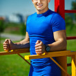 Handsome healthy happy srtong athlete male man exercising at the city park — Stock Photo #48276681