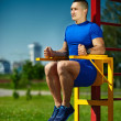 Handsome healthy happy srtong athlete male man exercising at the city park — Stock Photo #48276717