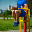 Handsome healthy happy srtong athlete male man exercising at the city park — Stock Photo #48276817