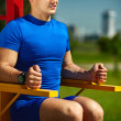 Handsome healthy happy srtong athlete male man exercising at the city park — Stock Photo #48276883