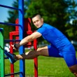Handsome healthy happy srtong athlete male man exercising at the city park — Stock Photo #48278027