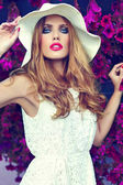 High fashion look.glamor closeup portrait of beautiful sexy stylish blond young woman model with bright makeup and pink lips with perfect clean skin in hat blue eyes — Stock Photo
