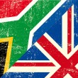 Wektor stockowy : English and South Africgrunge Flag