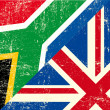 ストックベクタ: English and South Africgrunge Flag