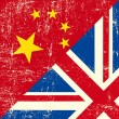 图库矢量图片: UK and Chinese grunge flag