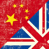 UK and Chinese grunge flag — Stock Vector