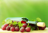 Red wine on green background — Stock Photo