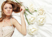 Sensual woman with rose — Stock Photo