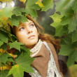 Autumn woman in leaves — Stock Photo