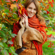 Stock Photo: Smiling woman - happy autumn