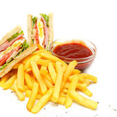 Club Sandwich with fries and red sauce — Stock Photo