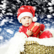 Cute baby with Christmas gift  — Stockfoto