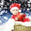 Cute baby with Christmas gift  — Stock Photo
