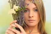 Woman with fllowers — Stock Photo