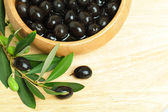 Olives with green leaves — Stock Photo