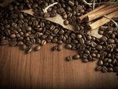 Coffee beans with cinnamon sticks — Stock Photo
