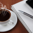 Coffee with blank notebook and phone — Stock Photo