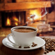 Hot coffee near fireplace — ストック写真
