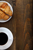 Coffee and croissants with copy space — Stock Photo