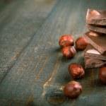 Chocolate with hazelnuts - copy space — Stock Photo #24012987