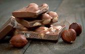 Milk chocolate with hazelnuts — Stock Photo