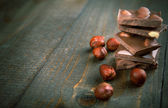 Chocolate with hazelnuts - copy space — Stock Photo