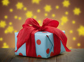 Gift box on evening magical background — Stock Photo