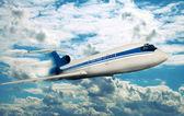 Passenger plane flying in the sky — Stock Photo