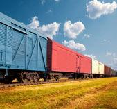 Freight train on railway — Stock Photo