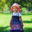 Cute little girl in summer park — Stock Photo