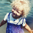 Happy little girl in summer sun — Stock Photo