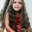 Little girl with delicious hair holding hairbrush — Foto Stock