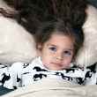 Little girl with delicious hair in bed — Stock Photo