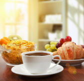 Healthy breakfast with coffee in sunny morning — Stock Photo