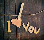 Paper words I love you on wooden board — Stock Photo