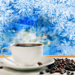 Hot coffee near frozen winter window — Stock Photo #41993167