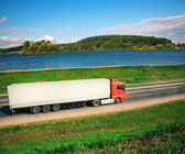 Truck on a road near water — Stock Photo