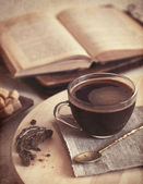 Fresh coffee with cookie and book - vintage textured — Stock Photo