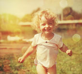 Happy little girl in summer sunlight. Vintage paper textured — Stock Photo